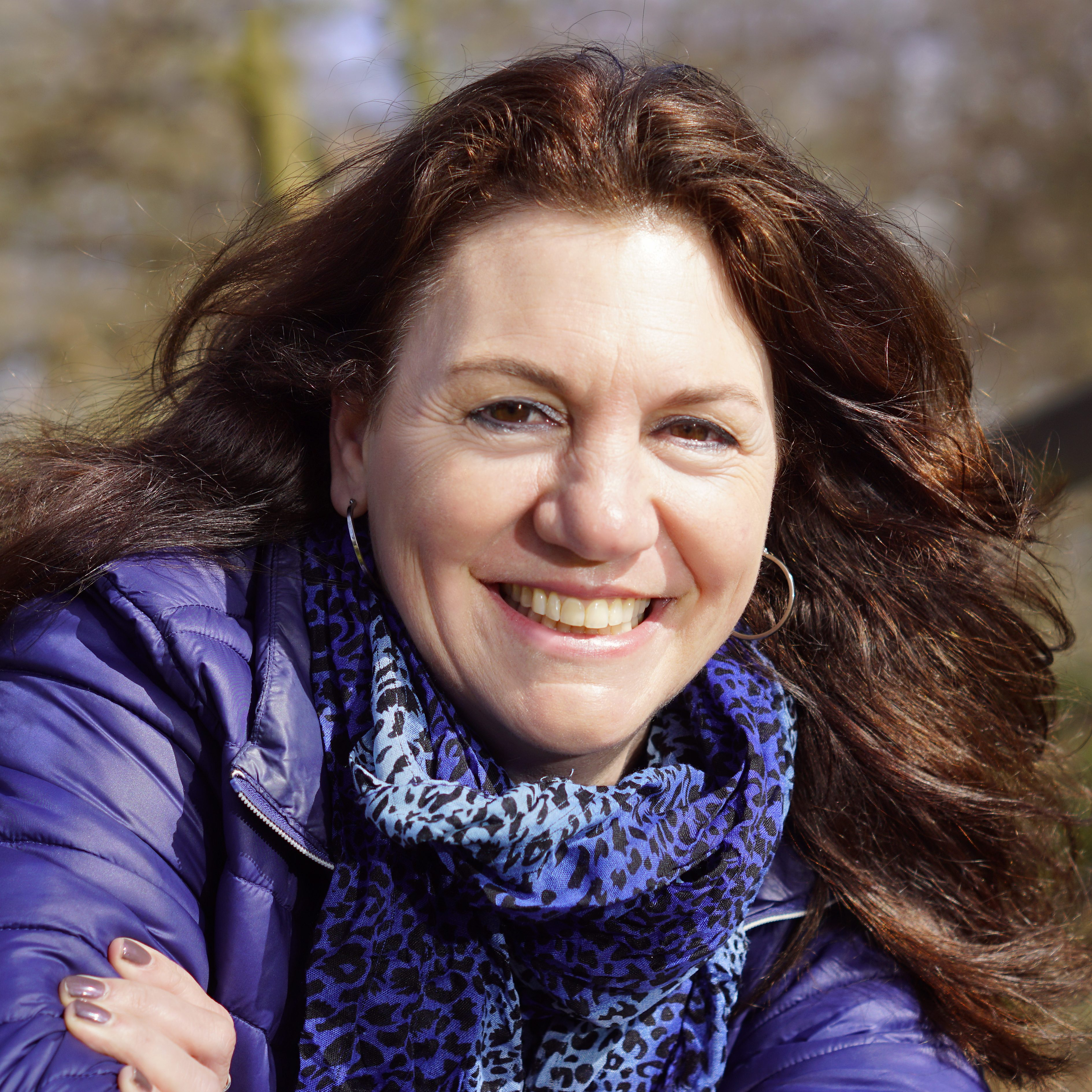 Lachende vrouw: testimonial Kitty Rodenburg voor Pauli Communications